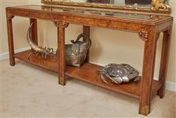 Sale 9097H - Lot 29 - A Burr walnut console table with carved detail, bevelled glass top and lower shelf, Height 69cm x Width 166cm x Depth 40cm