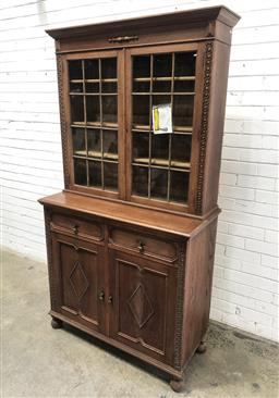 Sale 9126 - Lot 1170 - Edwardian/ 1920s Oak Bookcase, with two astragal doors, above two drawers & two doors with diamond motifs (h:204 w:107 d:47cm)2 keys...