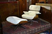 Sale 8115 - Lot 1234 - Reproduction Eames Style 670/671 Chair In White