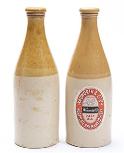 Sale 9185E - Lot 61 - A pair of pottery ale bottles, one with the label for Wadworth & Co. ltd Northgate brewery, Height 27cm  one chipped to base