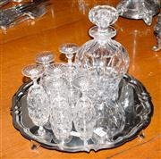 Sale 8015A - Lot 84 - One cut glass decanter six matching sherry glasses and a silver plated tray by Hardy Brothers raised on four feet.