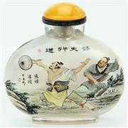 Sale 8390A - Lot 37 - Inside Painted Snuff Bottle depicting Warriors Fighting topped with a Yellow Lid