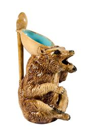 Sale 8888H - Lot 87 - An antique English majolica honey bear spoon jug, losses to teeth, H 25 cm