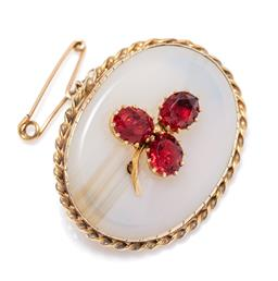 Sale 9213 - Lot 357 - A VINTAGE 9CT GOLD AGATE AND PASTE BROOCH; oval banded agate applied with a paste set three leaf clover to a rope twist surround and...