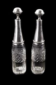 Sale 8224A - Lot 63 - A pair of antique French silver plate top crystal bottles and stoppers, faint hallmarks, height 28 cm