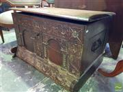 Sale 8539 - Lot 1069 - 17th Century Style Carved Oak Coffer, incorporating early elements with Hinged Top and Arcaded Front and a Sloping Plinth (Key in Of...