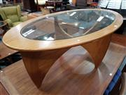 Sale 8741 - Lot 1020 - Oval G Plan Teak Atmos Coffee Table with Glass Top