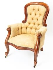 Sale 8960J - Lot 30 - A vintage carved mahogany arm chair with deep buttoned back upholstery in soft gold self patterned brocade, raised on brass castor t...