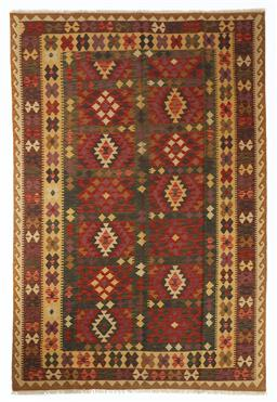 Sale 9123J - Lot 304 - A vintage Kilim rug, the diamond pattern within trectangular panes surrounded by repeating geometric borders over a wine coloured gr...