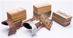 Sale 9185E - Lot 31 - Two vintage hand held stereoscopes together with an abundance of slides including views of Egypt, Comic store, Germany, etc, one ste...