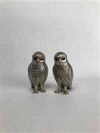 Sale 8725A - Lot 25 - A pair of silvered pewter owls with glass bead eyes by the Corbell silver company. Height 15cm