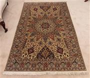 Sale 8881H - Lot 29 - A fine Persian carpet with central starburst and floral medallion in red and blue on cream ground. 208 x 128cm