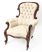 Sale 8960J - Lot 26 - An antique Australian Colonial cedar Armchair C: 1860. The scroll carved and shaped deep buttoned back on padded and buttoned arms. ...