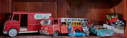 Sale 9103H - Lot 12 - A shelf lot of tin plate toys including a nail truck, fire engine, Bugatti and various cars.