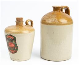 Sale 9185E - Lot 18 - An A. Coakley wine & spirit merchant Daylesford demijohn together with a Jeroboam example, Height of taller 25cm, with chips