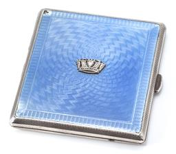 Sale 9164J - Lot 376 - A HALLMARKED ENAMELLED SILVER CIGARETTE CASE; engine turned case with sky blue enamel to the front (chips to corners) applied in the...