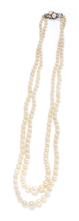 Sale 9213 - Lot 344 - A VINTAGE DOUBLE STRAND GRADUATED PEARL NECKLACE; 3.5 - 8mm round cultured pearls of good colour and lustre to an 18ct white gold cl...