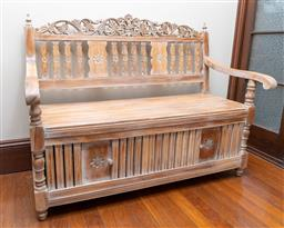 Sale 9260M - Lot 53 - A teak settle of European influence with distressed painted finish, the lower storage compartment accessible via two sliding doors H...