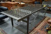 Sale 8532 - Lot 1427 - Industrial Dining Table with Forged Metal Legs and Glass Brick Top