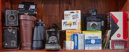 Sale 9103H - Lot 13 - A collection of cameras and binoculars to include Kodak Brownies and viewers.