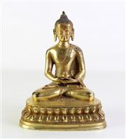 Sale 8926A - Lot 674 - Tibetan gilt bronze figure of Shakyamuni seated on double lotus base (H22cm)