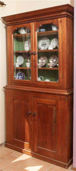 Sale 9120H - Lot 11 - A C19th pine display cabinet over two glazed and two lower doors with shelved interior.  Height 192cm x Width 107cm x Depth 32cm