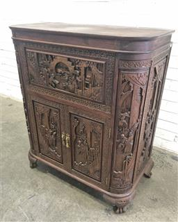Sale 9126 - Lot 1192 - Chinese Profusely Carved Teak Bar, with several vignettes of domestic scenes, the hinged top revealing two further flaps with attach...