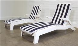Sale 9215 - Lot 1547 - Pair of plastic poolside lounge chairs (h98 x w65 x d185cm)