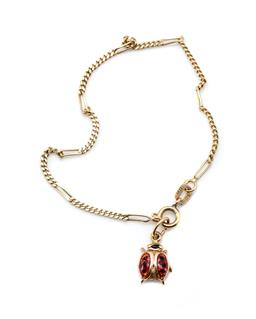 Sale 9253J - Lot 517 - A 14CT CHARM BRACELET; 1.7mm wide long and short curb links to a bolt ring clasp, length 16cm, attached with an enamelled ladybird c...