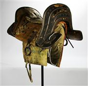 Sale 8123 - Lot 16 - East Tibetan Ceremonial Horse Saddle on Stand