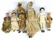 Sale 8330T - Lot 82 - Six Small Dolls; 5 German bisque head dolls/ doll house dolls with cloth bodies and ceramic figure of Pierrot 3-7.