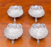 Sale 8346A - Lot 17 - A set of four Victorian Rococo style silver open salts of shell form raised on dolphin supports, H. A, Birmingham, W 6.5cm