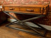 Sale 8420A - Lot 91 - An aged leather luggage inspired console table with steel cross base featuring pull out drawers lined in grey suede, measurements: 1...