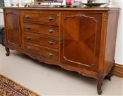 Sale 8414A - Lot 16 - A sideboard in the Continental taste with two doors flanking four central drawers raised on short cabriole legs, with glass top, H 9...