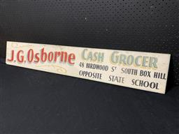 Sale 9188 - Lot 1024 - Early hand painted grocer sign on timber backing (h:19 x w:120cm)
