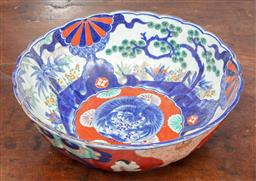 Sale 9120H - Lot 12 - A Japanese scalloped bowl with central blue bird motif surrounded by flowers and bamboos, mark to base, Diameter 29cm