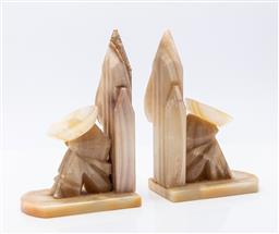 Sale 9185 - Lot 12 - A pair of alabaster bookends depicting a person resting by a cactus (H: 19cm)