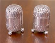 Sale 8346A - Lot 64 - A pair of silver Victorian pepper pots of capsule form raised on three ball feet, each monogrammed, H 5cm