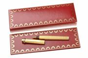 Sale 8517 - Lot 323 - LE MUST DE CARTIER GOLD PLATED BALLPOINT PEN; bark texture, s/n. 465890, boxed with booklet.