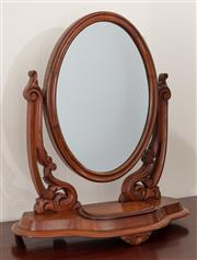 Sale 8912H - Lot 95 - An antique English mahogany toilet mirror C: 1875, the oval mirror on carved scroll supports above the shaped base fitted with a lif...