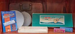Sale 9103H - Lot 15 - A shelf lot of music related items including tambourines, mouth organs, glockenspiel etc.