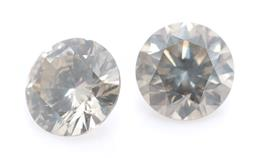 Sale 9186 - Lot 387 - A PAIR OF UNSET ROUND BRILLIANT CUT DIAMONDS; 0.20ct (chipped), 3.73 X 2.22mm and 0.21ct, 3.66 x 2.40mm, both gray, P1