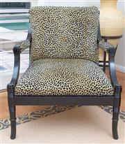 Sale 8562A - Lot 142 - An oversized ebonised bergere with pierced back and bamboo style legs, with animal print upholstery, H of back 80 x W 74cm