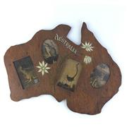 Sale 8793 - Lot 51 - Australia, a carved wooden map featuring 4 postcards c1916, with painted title and flannel flowers, 51cm wide