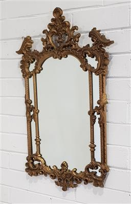 Sale 9188 - Lot 1556 - An ornate gilt framed sectioned mirror - slight chip to bottom (74x45cm)