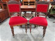 Sale 8792 - Lot 1006 - Set of Six Edwardian Walnut Dining Chairs, the carved buttoned backs upholstered in red velvet and raised on turned legs on castors