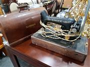 Sale 8843 - Lot 1035 - Timber Cased Sewing Machine