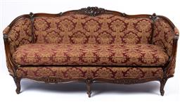 Sale 9135H - Lot 61 - A French 19th Century carved walnut sofa,  2M Width