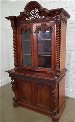 Sale 9179 - Lot 1070 - Probably 19th Century Dutch-Colonial Mahogany Bookcase, with pierced arched crest, above two carved glass panel doors, flanked by ba...