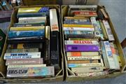 Sale 8013 - Lot 1802 - 2 Boxes of Various Books mostly Novels incl. Wouk, H. The Cane Mutiny; Smith, W. Cry Wolf; etc